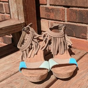 Suede Minnetonka wedge sandals with fringe